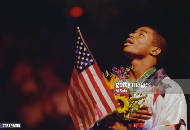 David Reid of the United States raises the Stars and Stripes flag whilst singing the national anthem after winning the Light middleweight boxing...