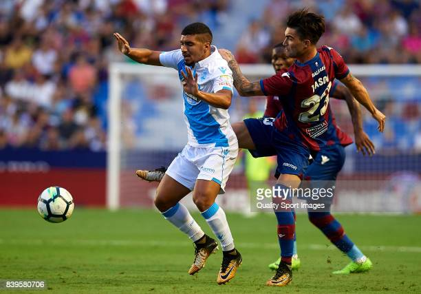 David Remeseiro Jason of Levante competes for the ball with Zakaria Bakkali of Deportivo during the La Liga match between Levante and Deportivo La...