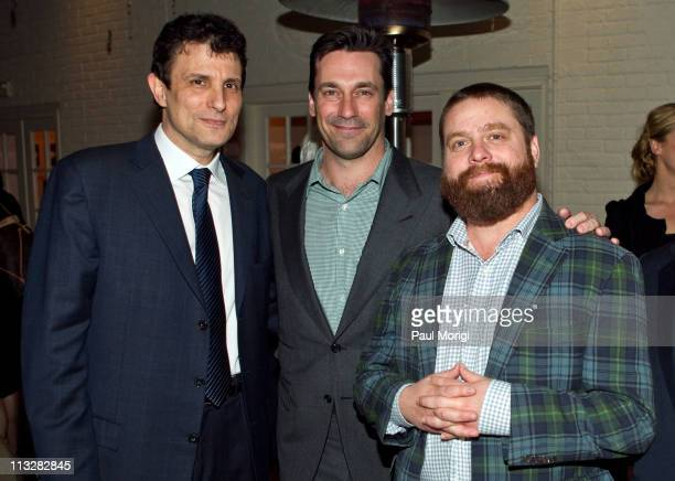 David Remnick editor of The New Yorker Jon Hamm and Zach Galifianakis pose for a photo at the New Yorker White House Correspondents' dinner preparty...
