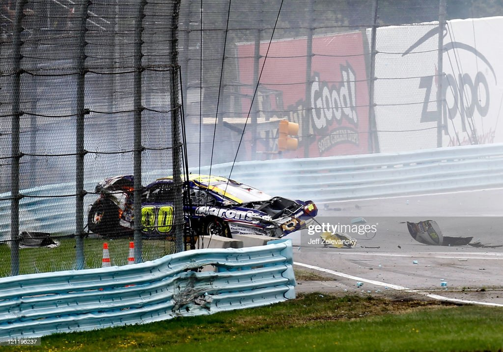 David Reutimann crashes the Aaron's Dream Machine Toyota into the wall after an incident in the NASCAR Sprint Cup Series Heluva Good Sour Cream Dips...