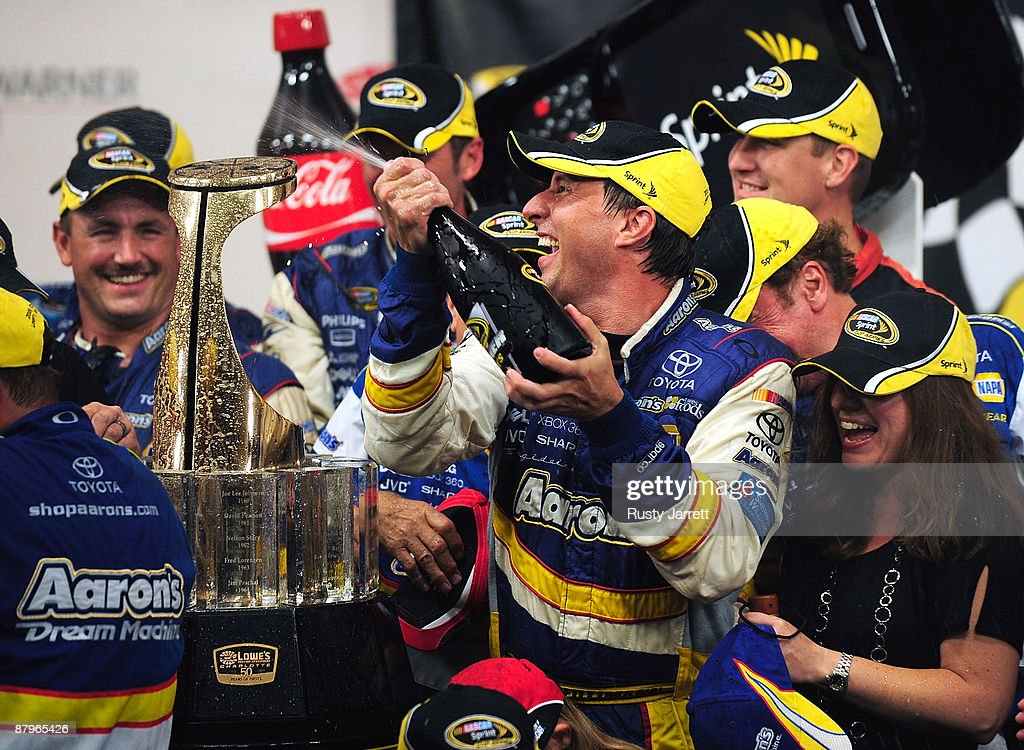 David Reutimann driver of the Aaron's Dream Machine Toyota celebrates in victory lane after winning the NASCAR Sprint Cup Series CocaCola 600 on May...