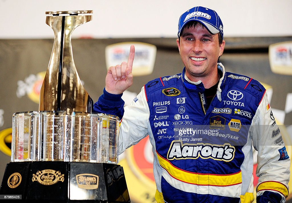 David Reutimann driver of the Aaron's Dream Machine Toyota poses in victory lane after winning the NASCAR Sprint Cup Series CocaCola 600 on May 25...