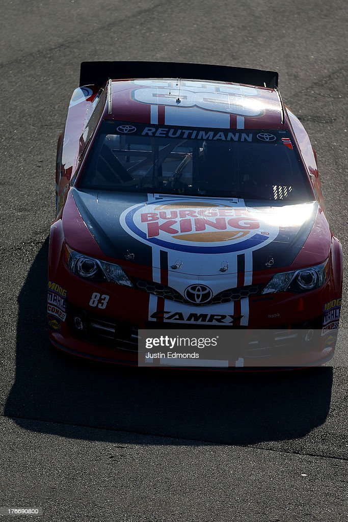 David Reutimann, driver of the #83 Burger King / Dr. Pepper Toyota, drives in the garage area during practice for the NASCAR Sprint Cup Series 44th Annual Pure Michigan 400 at Michigan International Speedway on August 17, 2013 in Brooklyn, Michigan.
