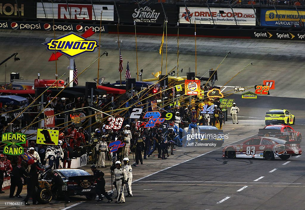 David Reutimann, driver of the #83 Burger King / Dr. Pepper Toyota, is involved in an incident on pit road during the NASCAR Sprint Cup Series 53rd Annual IRWIN Tools Night Race at Bristol Motor Speedway on August 24, 2013 in Bristol, Tennessee.