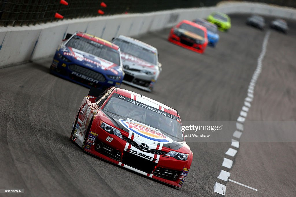 David Reutimann, driver of the #83 Burger King / Dr. Pepper Toyota, leads a pack of cars during the NASCAR Sprint Cup Series AAA Texas 500 at Texas Motor Speedway on November 3, 2013 in Fort Worth, Texas.