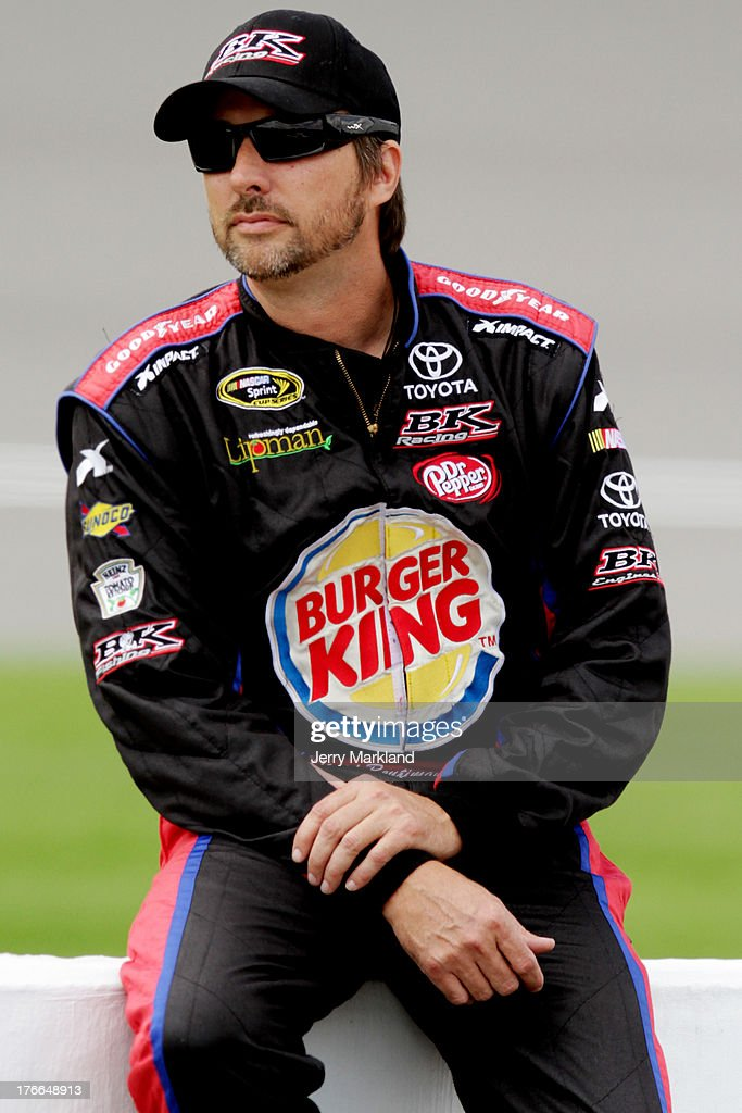 David Reutimann, driver of the #83 Burger King / Dr. Pepper Toyota, looks on from the grid during qualifying for the NASCAR Sprint Cup Series 44th Annual Pure Michigan 400 at Michigan International Speedway on August 16, 2013 in Brooklyn, Michigan.