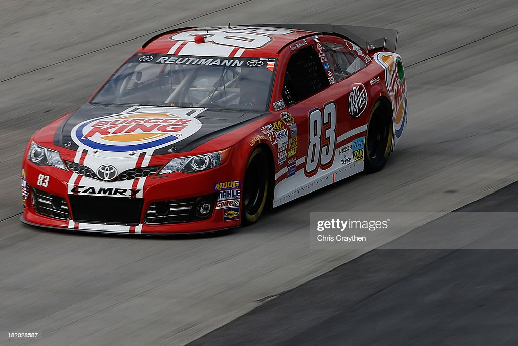 David Reutimann, driver of the #83 Burger King / Dr. Pepper Toyota, practices for the NASCAR Sprint Cup Series AAA 400 at Dover International Speedway on September 27, 2013 in Dover, Delaware.