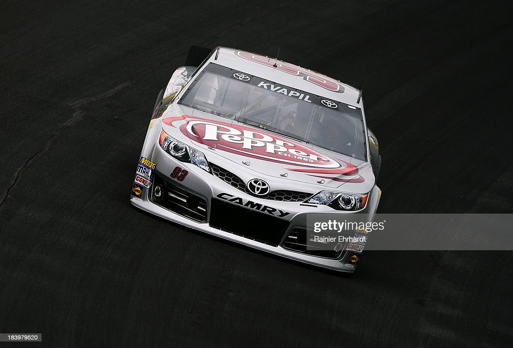 David Reutimann, driver of the #83 Burger King / Dr. Pepper Toyota, practices for the NASCAR Sprint Cup Series Bank of America 500 at Charlotte Motor Speedway on October 10, 2013 in Concord, North Carolina.