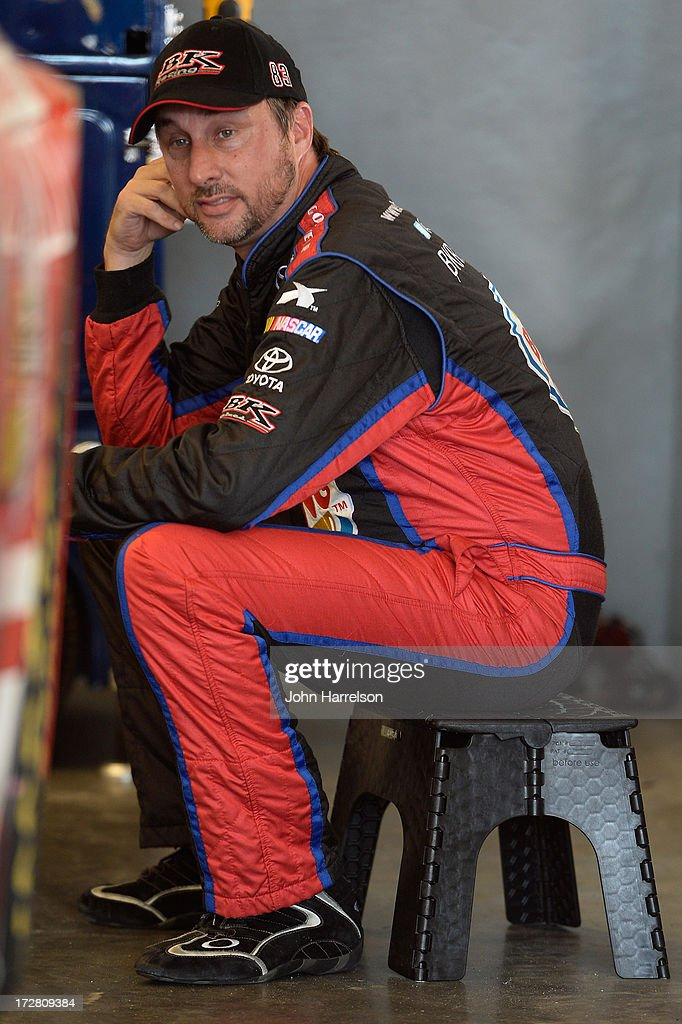 David Reutimann, driver of the #83 Burger King / Dr. Pepper Toyota, sits in the garage during practice for the NASCAR Sprint Cup Series Coke Zero 400 at Daytona International Speedway on July 4, 2013 in Daytona Beach, Florida.