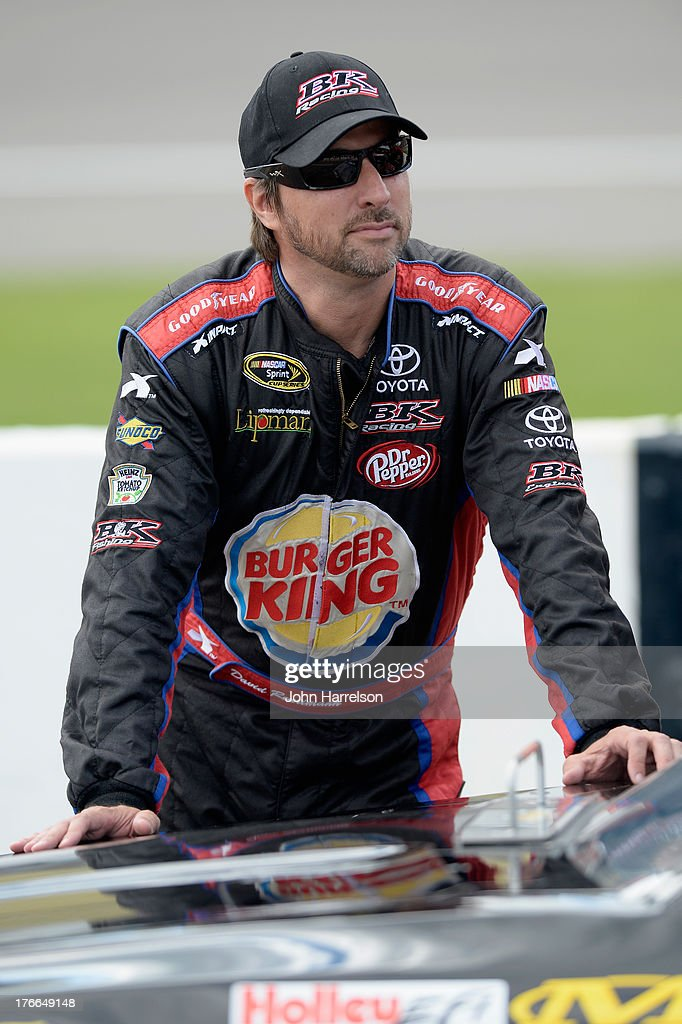 David Reutimann, driver of the #83 Burger King / Dr. Pepper Toyota, stands on the grid during qualifying for the NASCAR Sprint Cup Series 44th Annual Pure Michigan 400 at Michigan International Speedway on August 16, 2013 in Brooklyn, Michigan.