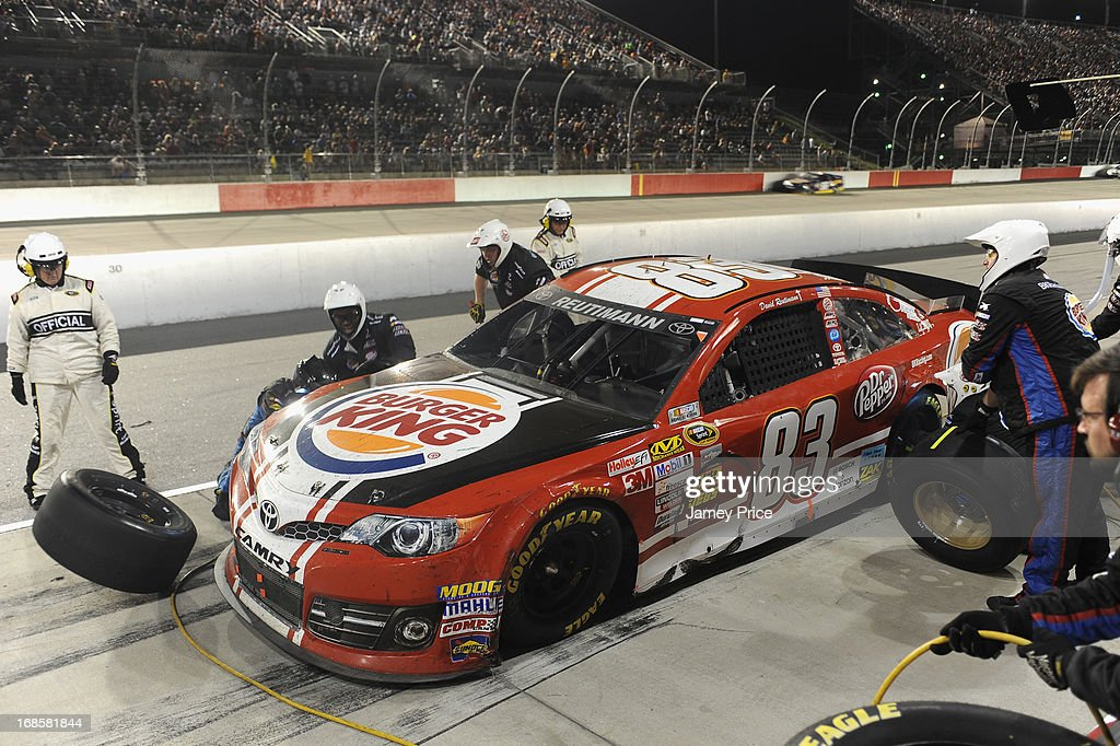 David Reutimann, driver of the #83 Burger King/Dr Pepper Toyota, comes in for a pit stop during the NASCAR Sprint Cup Series Bojangles' Southern 500 at Darlington Raceway on May 11, 2013 in Darlington, South Carolina.