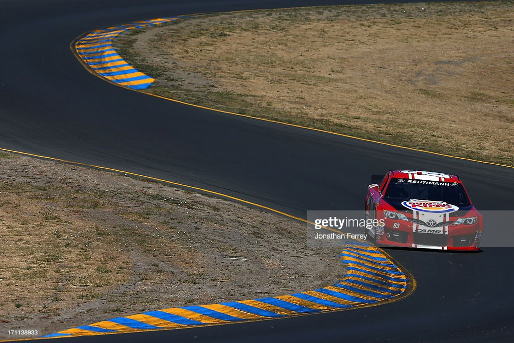 David Reutimann, driver of the #83 Burger King/Dr Pepper Toyota, drives during qualifying for the NASCAR Sprint Cup Series Toyota/Save Mart 350 at Sonoma Raceway on June 22, 2013 in Sonoma, California.