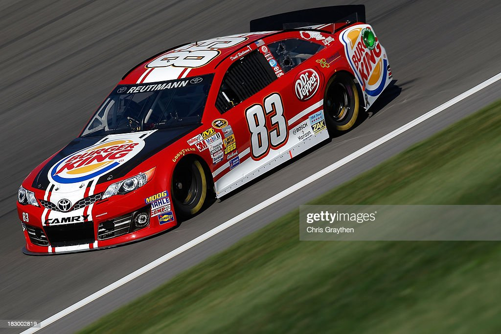 David Reutimann, driver of the #83 Burger King/Dr Pepper Toyota, drives during testing for the NASCAR Sprint Cup Series at Kansas Speedway on October 3, 2013 in Kansas City, Kansas.