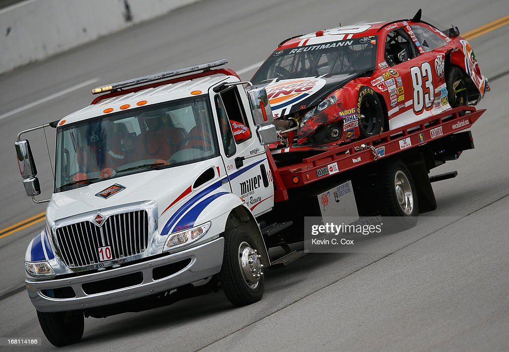 David Reutimann, driver of the #83 Burger King/Dr. Pepper Toyota, is hauled away after a wreck in between turn one and two during the NASCAR Sprint Cup Series Aaron's 499 at Talladega Superspeedway on May 5, 2013 in Talladega, Alabama.