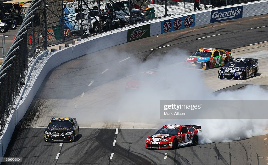 David Reutimann, driver of the #83 Burger King/Dr Pepper Toyota, is involved in an incident during the NASCAR Sprint Cup Series STP Gas Booster 500 on April 7, 2013 at Martinsville Speedway in Ridgeway, Virginia.