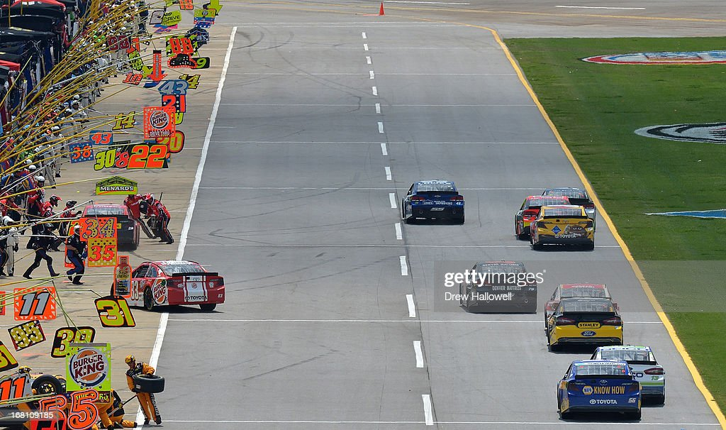 David Reutimann, driver of the #83 Burger King/Dr. Pepper Toyota, pits during the NASCAR Sprint Cup Series Aaron's 499 at Talladega Superspeedway on May 5, 2013 in Talladega, Alabama.