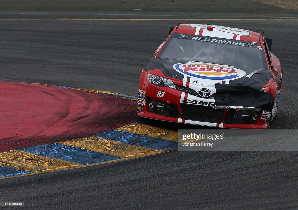 David Reutimann, driver of the #83 Burger King/Dr Pepper Toyota, races during the NASCAR Sprint Cup Series Toyota/Save Mart 350 at Sonoma Raceway on June 23, 2013 in Sonoma, California.