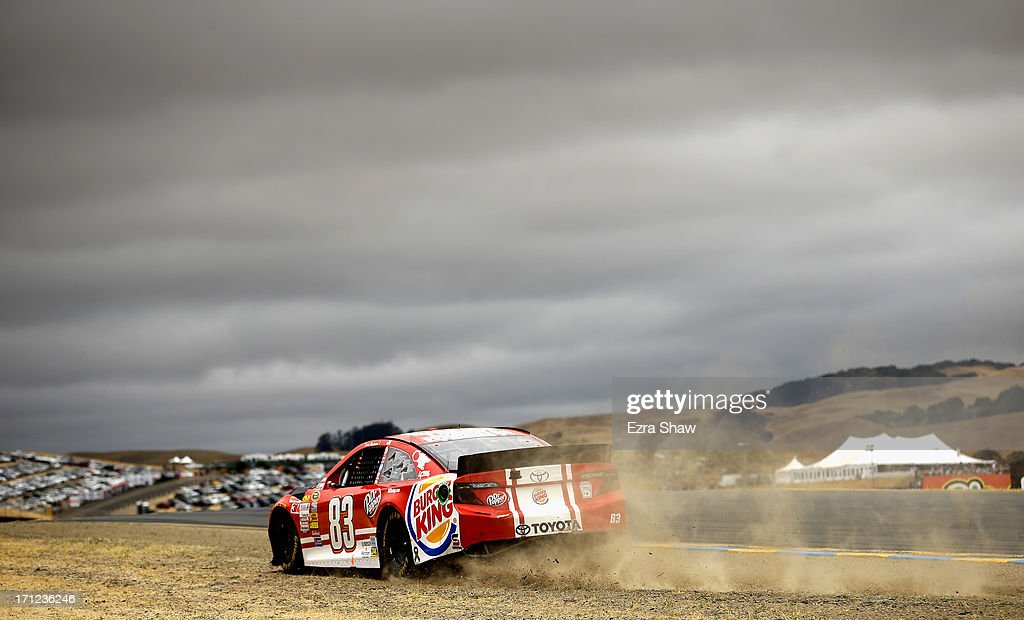 David Reutimann, driver of the #83 Burger King/Dr Pepper Toyota, runs off course during the NASCAR Sprint Cup Series Toyota/Save Mart 350 at Sonoma Raceway on June 23, 2013 in Sonoma, California.