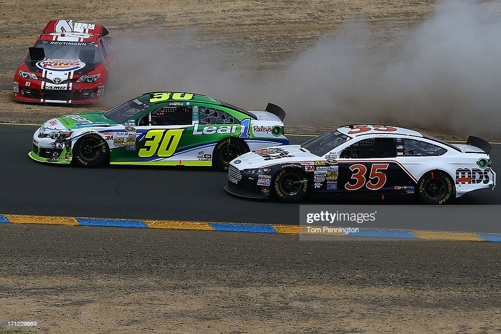 David Reutimann, driver of the #83 Burger King/Dr Pepper Toyota, spins during the NASCAR Sprint Cup Series Toyota/Save Mart 350 at Sonoma Raceway on June 23, 2013 in Sonoma, California.