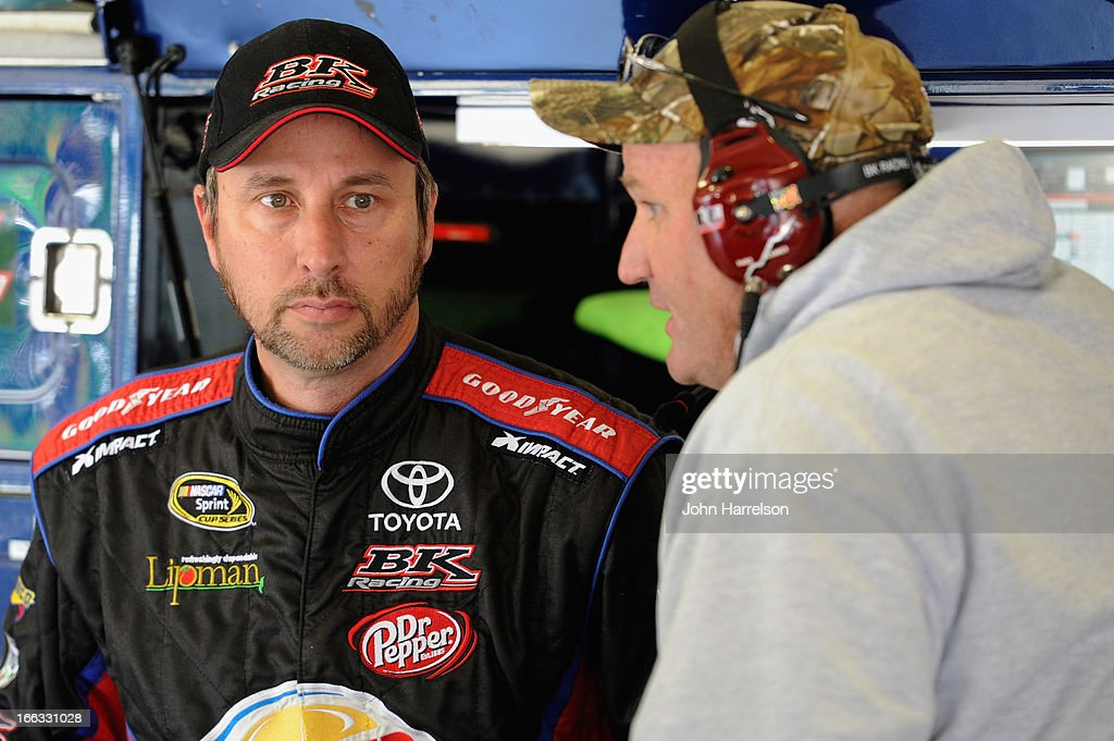 David Reutimann, driver of the #83 Burger King/Dr Pepper Toyota, stands in the garage area with crew chief Pat Tryson during NASCAR Sprint Cup Series Gen-6 Testing at Texas Motor Speedway on April 11, 2013 in Fort Worth, Texas.