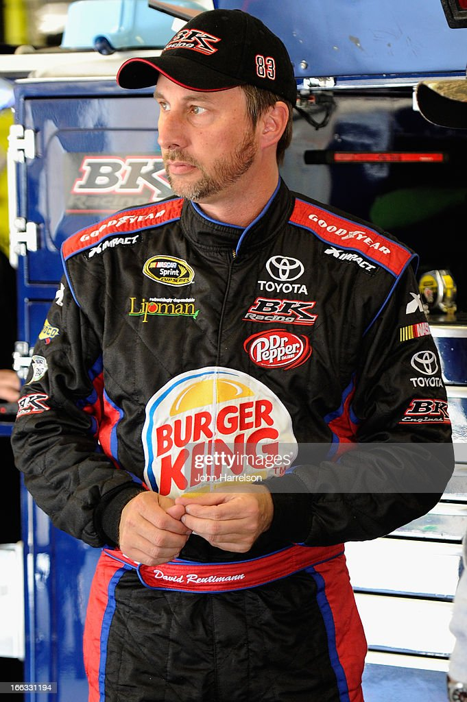David Reutimann, driver of the #83 Burger King/Dr Pepper Toyota, stands in the garage area during NASCAR Sprint Cup Series Gen-6 Testing at Texas Motor Speedway on April 11, 2013 in Fort Worth, Texas.