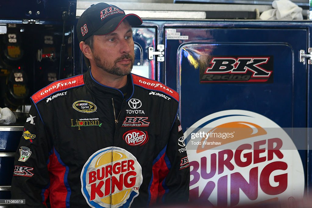 David Reutimann, driver of the #83 Burger King/Dr Pepper Toyota, stands in the garage area during practice for the NASCAR Sprint Cup Series Toyota/Save Mart 350 at Sonoma Raceway on June 21, 2013 in Sonoma, California.