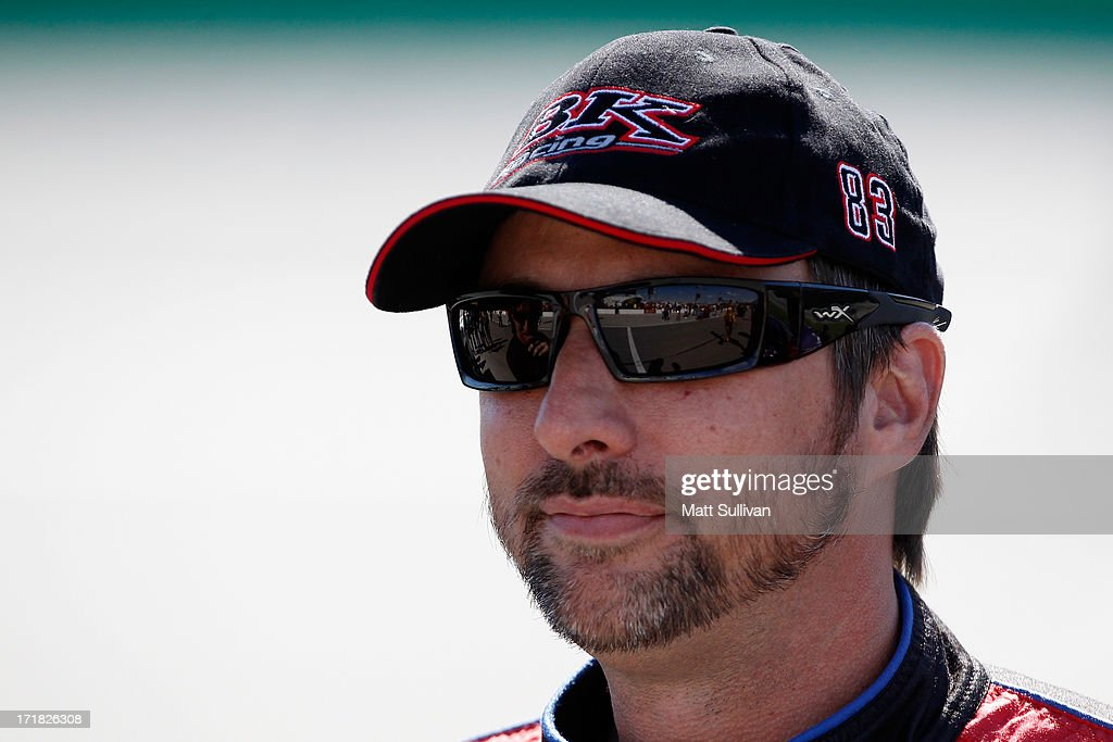 David Reutimann, driver of the #83 Burger King/Dr.Pepper Toyota, looks on during qualifying for the NASCAR Sprint Cup Series Quaker State 400 at Kentucky Speedway on June 28, 2013 in Sparta, Kentucky.
