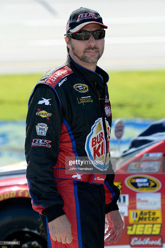 David Reutimann, driver of the #83 Burger King/Dr.Pepper Toyota, stands by his car during qualifying for the NASCAR Sprint Cup Series Quaker State 400 at Kentucky Speedway on June 28, 2013 in Sparta, Kentucky.