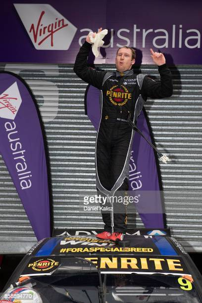 David Reynolds driver of the Erebus Motorsport Penrite Racing Holden Commodore VF celebrates after winning the Bathurst 1000 which is part of the...