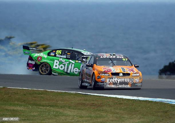 David Reynolds driver of the The BottleO Racing Ford spins off the track after a colision with Shane van Gisbergen driver of the Team TEKNO Darrell...