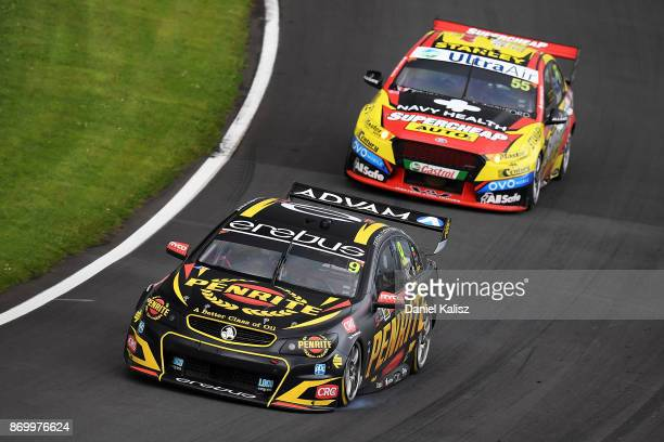 David Reynolds drives the Erebus Motorsport Penrith Racing Holden Commodore VF leads Chaz Mostert drives the Supercheap Auto Racing Ford Falcon FGX...