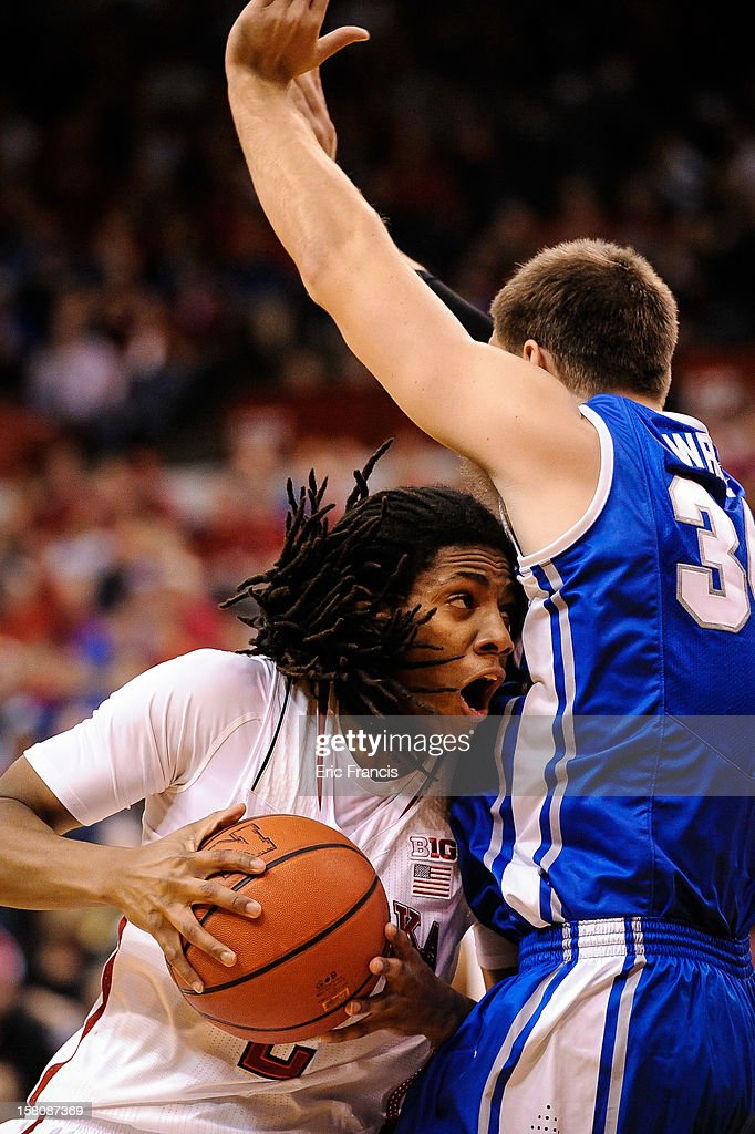 David Rivers #2 of the Nebraska Cornhuskers drives into Ethan Wragge #34 of the Creighton Bluejays during their game at the Devaney Center on December 6, 2012 in Lincoln, Nebraska.