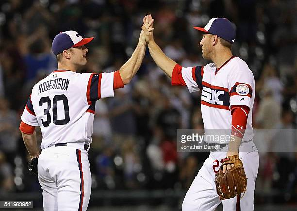 David Robertson and Todd Frazier of the Chicago White Sox celebrate a win against the Detroit Tigers at US Cellular Field on June 15 2016 in Chicago...