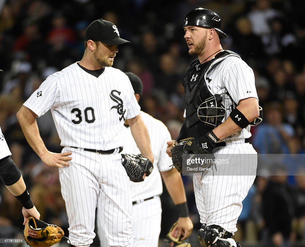 David Robertson #30 of the Chicago White Sox and Tyler Flowers #21 talk on the mound during the ninth inning of a game against the Texas Rangerson June 19, 2015 at U. S. Cellular Field in Chicago, Illinois. The Rangers defeated the White Sox 2-1.