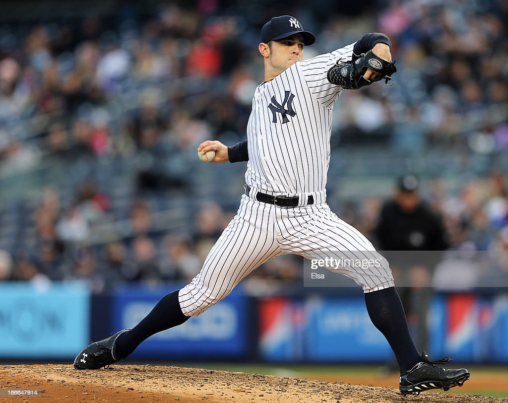David Robertson #30 of the New York Yankees delivers a pitch against the Baltimore Orioles on April 13, 2013 at Yankee Stadium in the Bronx borough of New York City.The Baltimore Orioles defeated the New York Yankees 5-3.
