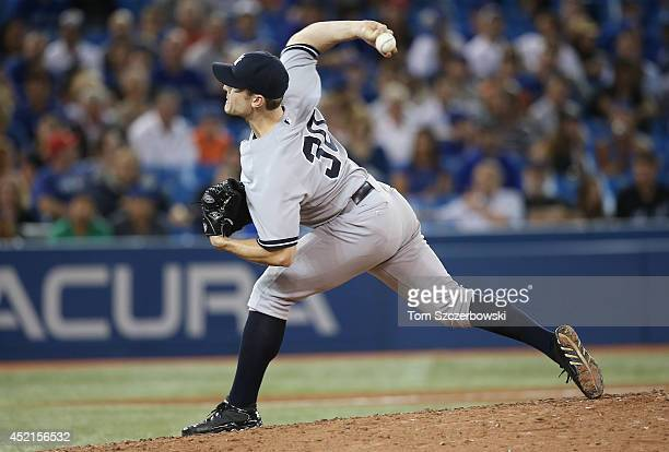 David Robertson of the New York Yankees delivers a pitch in the ninth inning during MLB game action against the Toronto Blue Jays on June 25 2014 at...
