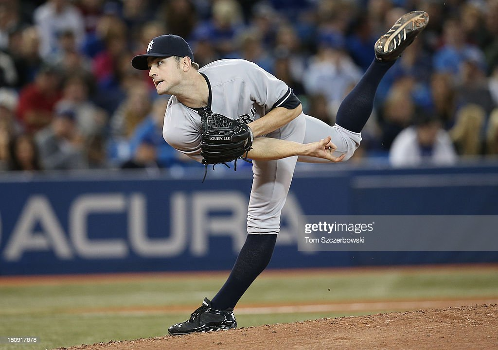 David Robertson #30 of the New York Yankees delivers a pitch in the eighth inning during MLB game action against the Toronto Blue Jays on September 17, 2013 at Rogers Centre in Toronto, Ontario, Canada.