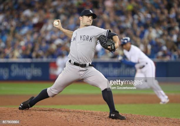 David Robertson of the New York Yankees delivers a pitch in the eighth inning during MLB game action against the Toronto Blue Jays at Rogers Centre...