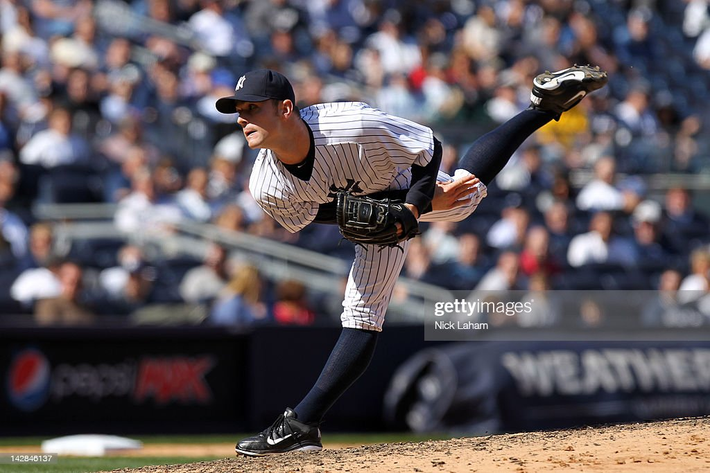 David Robertson #30 of the New York Yankees pitches against the Los Angeles Angels during the home opener at Yankee Stadium on April 13, 2012 in the Bronx borough of New York City.