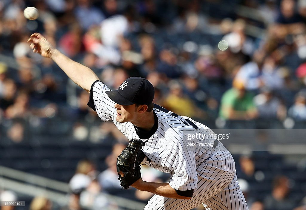 David Robertson #30 of the New York Yankees pitches against the Tampa Bay Rays at Yankee Stadium on September 16, 2012 in the Bronx borough of New York City.