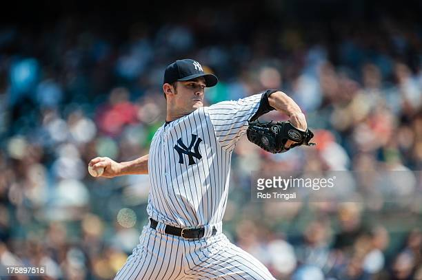 David Robertson of the New York Yankees pitches against the Tampa Bay Rays at Yankee Stadium on July 27 2013 in the Bronx borough of Manhattan