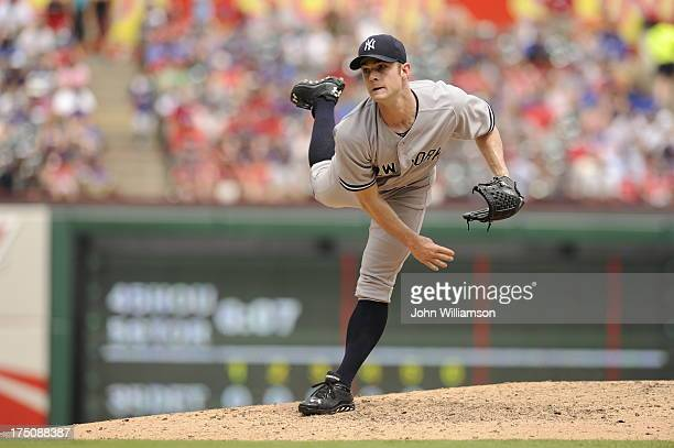David Robertson of the New York Yankees pitches against the Texas Rangers at Rangers Ballpark on July 25 2013 in Arlington Texas The New York Yankees...
