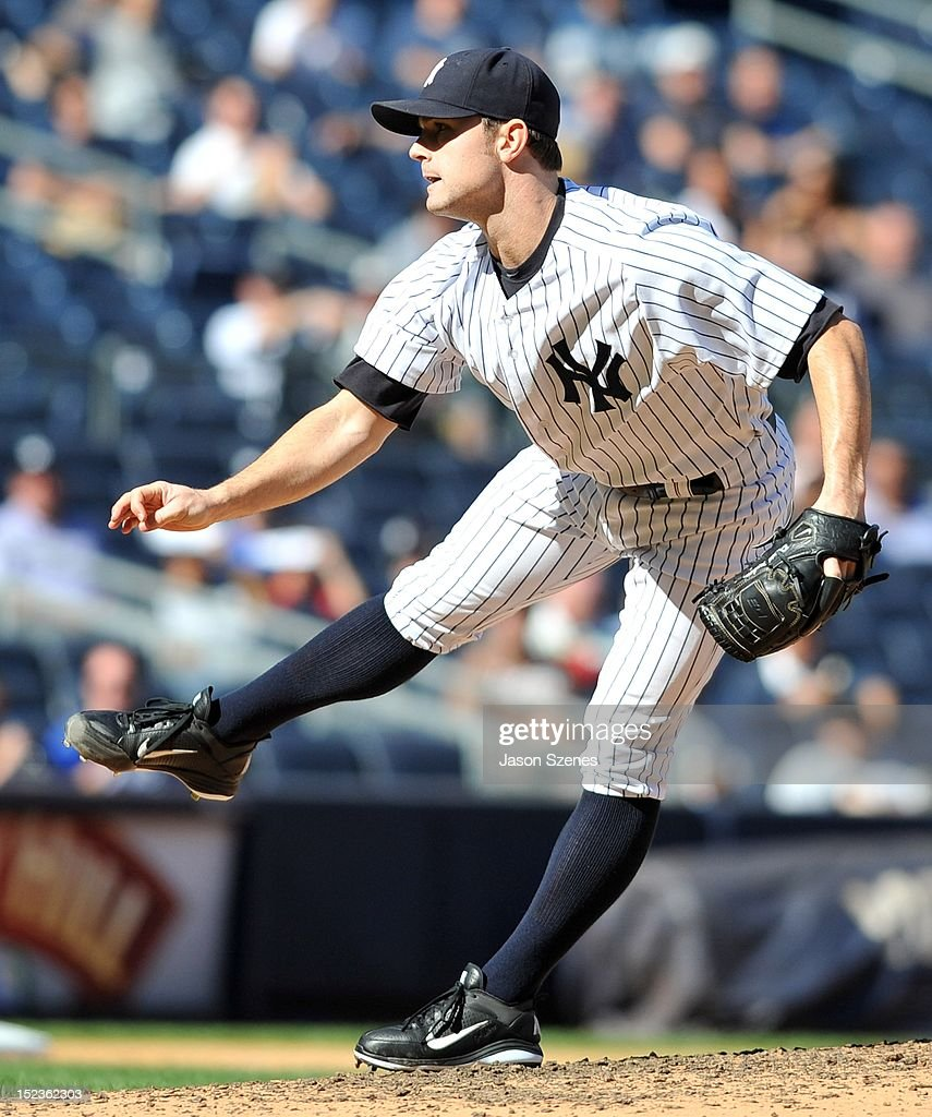 David Robertson #30 of the New York Yankees pitches against the Toronto Blue Jays during the first game of a double header at Yankee Stadium on September 19, 2012 in the Bronx borough of New York City.