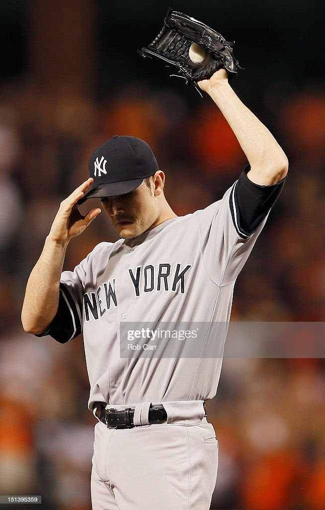 David Robertson #30 of the New York Yankees reacts after giving up a home run during the eighth inning of the Yankees 10-6 loss to the Baltimore Orioles at Oriole Park at Camden Yards on September 6, 2012 in Baltimore, Maryland.