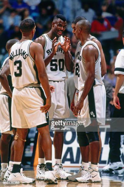 David Robinson goes over the game plan with Monty Williams Tim Duncan and Sean Elliott of the San Antonio Spurs against Patrick Ewing of the New York...
