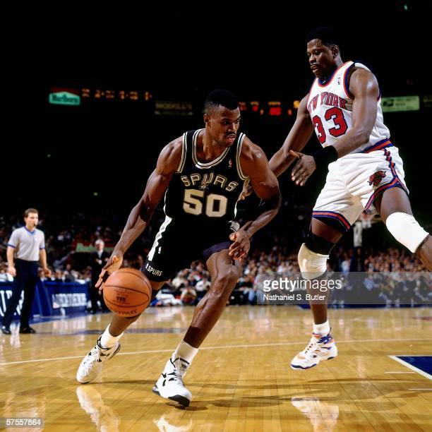 David Robinson of the San Antonio Spurs drives to the basket against Patrick Ewing of the New York Knicks at Madison Square Garden on November 21...