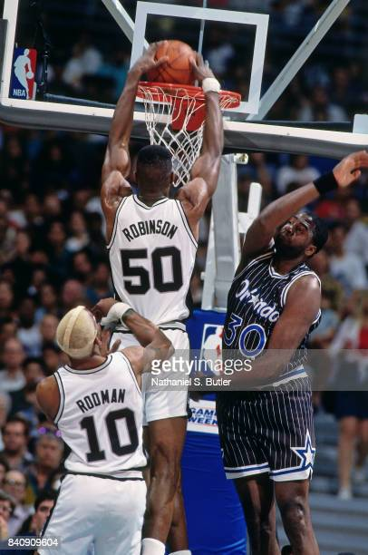 David Robinson of the San Antonio Spurs dunks against the Orlando Magic circa 1994 at the Alamo Dome in San San Antonio Texas NOTE TO USER User...