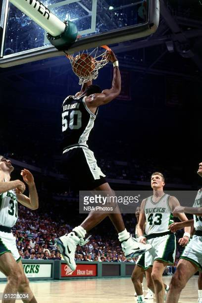 David Robinson of the San Antonio Spurs goes up for a dunk against the Milwaukee Bucks during an NBA game in 1990 at Bradley Center in Milwaukee...