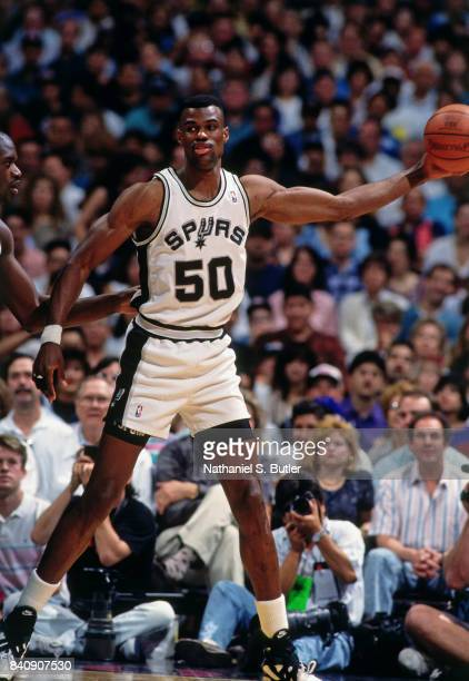 David Robinson of the San Antonio Spurs handles the ball against the Orlando Magic circa 1994 at the Alamo Dome in San San Antonio Texas NOTE TO USER...