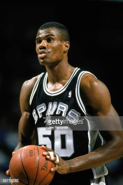 David Robinson of the San Antonio Spurs readies for the play during the game circa 1989 1990 in Dallas Texas